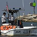 New Buffalo Michigan Police Boat Patrolling Harbor by Christopher Purcell