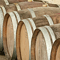 Oak Wine Barrels In Castillion La Bataille, France by Steven Morris Photography