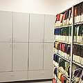 Office Cabinets And Colorful Files by Jetta Productions, Inc