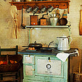 Old Cast Iron Cook Stove by Carmen Del Valle