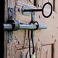 Old Door Of Wood With Its Worn Lock by Bernard Jaubert