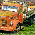 Old Dumptruck On Brick Background-ca by Randy Harris
