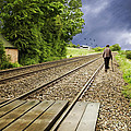 Old Man Walks Along Train Tracks by Amanda Elwell