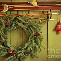 Old Pair Of Skis Hanging With Wreath  by Sandra Cunningham