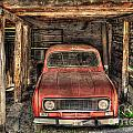 Old Red Car In A Wood Garage by Mats Silvan