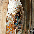 Old Tractor Wheel by Todd Blanchard