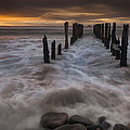 Old Wharf At Sunrise Saint Clair Beach by Colin Monteath