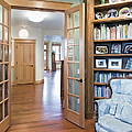 Open French Doors And Home Library by Andersen Ross