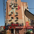 Painted Building  by Alfred Ng