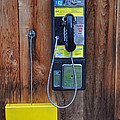Pay Phone And Book Wooden And Yellow by Bruce Gourley