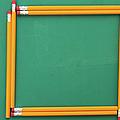 Pencils Framing An Area Of Chalkboard by Jon Schulte