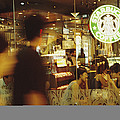 People At One Of The First Starbucks by Justin Guariglia