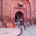 People Entering The Entrance Gate To The Red Colored Red Fort In New Delhi In India by Ashish Agarwal