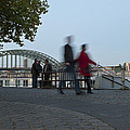 People Walk Along The Rhine River by Greg Dale