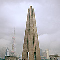 Peoples Heroes Monument In Shanghai In China by Shaun Higson