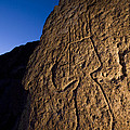 Petroglyphs Are Seen At Twilight by Ralph Lee Hopkins