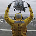 Petty Officer Guides An Sh-60r Sea Hawk by Stocktrek Images