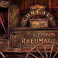 Pharmacy - The Rheumatic Cure Wagon  by Mike Savad