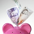 Piggy Bank And British Pounds by Tek Image