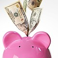 Piggy Bank And Us Dollars by Tek Image