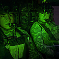 Pilots In The Cockpit Of An Oh-58d by Terry Moore