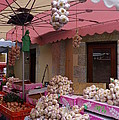 Pink Umbrella And Garlic by Carla Parris