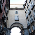 Plaza Mayor Arched Entrance In Madrid Spain by John Shiron