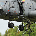 Polish Special Forces Member Fast-ropes by Stocktrek Images