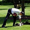 President Barack Obama Pets The Family by Everett