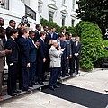 President Barack Obama Waves To Coach by Everett