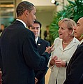 President Obama Talks With German by Everett