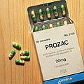 Prozac Pack With Pills On Wooden Surface by Damien Lovegrove