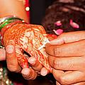 Putting The Gold And Diamond Engagement Ring On The Finger Of The Lady by Ashish Agarwal