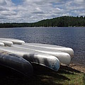 Racks Of Canoe's On Bear Pond Lake In The Adirondacks Ny by Sven Migot