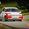 Red And White Renault 5 by Alain De Maximy