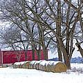 Red Barn In Winter With Hay Bales by Randall Nyhof