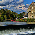 Red Canoes At The Boathouse by Paul Ward