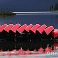 Red Canoes Maligne Lake by Bob Christopher