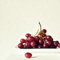 Red Grapes On White Plate by Photo by Ira Heuvelman-Dobrolyubova