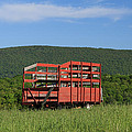 Red Hay Wagon In Green Mountain Field by John Stephens