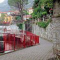Red Rail Walkway To Varenna Along Lake Como by Greg Matchick