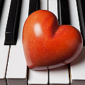 Red Stone Heart On Piano Keys by Garry Gay