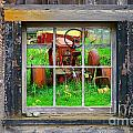 Red Tractor Thru Old Window by Randy Harris