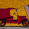 Red Truck Against Yellow Wall by Garry Gay