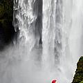 Red Umbrella At Skogafoss by Kenneth Blye