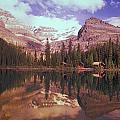 Reflection Of Cabins And Mountains In by Carson Ganci
