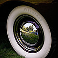Reflections In A Hubcap by Steve McKinzie