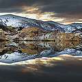 Reflections Of Cliffs On Blue Lake St Bathans by Colin Monteath