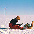 Researcher Measures The Flow Rate Of A Glacier by David Vaughan