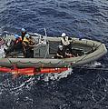 Rigid-hull Inflatable Boat Operators by Stocktrek Images